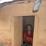 Girl standing in doorway of her isolation hut