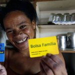 Maria Nitza shows her card for a cash transfer scheme in Brazil