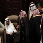 Saudi Shura members wait to speak with Saudi King Abdullah