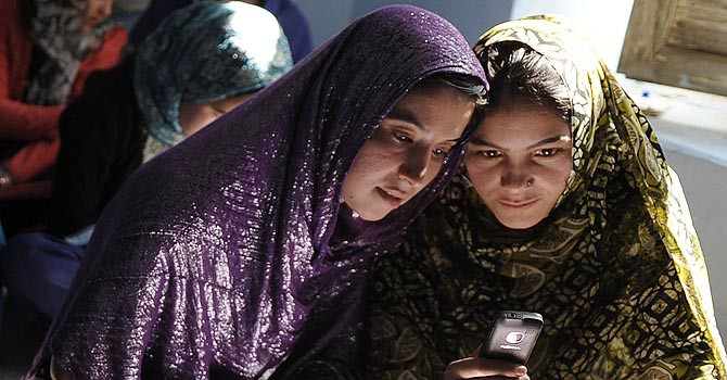 Afghan women educated through cellphones