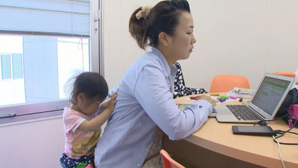 Japan rethinks cultural bias against working mothers