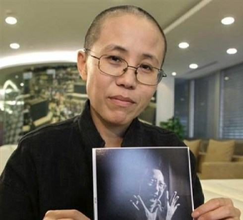 Ms. Liu Xia with picture of husband