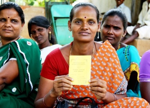 A dalit women in Tamil Nadu holds up her training certificate.