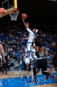Jordin Canada slices through the South Carolina defense to score. Photo by Don Liebig, UCLA Athletics.