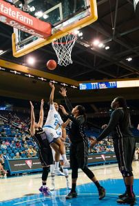 Monique Billings forces up a shot. Photo by Percy Anderson.