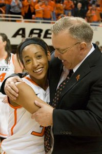 Jim Littell celebrates a win with former Cowgirl Tiffany Bias. Photo courtesy of Oklahoma State Athletics.