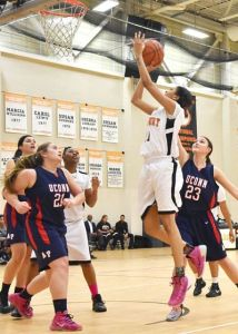 Alyssa Stewart with the put back, as Taj Lewis looks on. Photo by Phuong Tang, RCC Marketing Department.