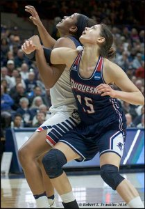 Connecticut's Morgan Tuck and Duquesne's Amadea Szamosi grapple for the rebound. Photo by Robert Franklin.