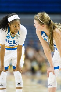 Jordin Canada and Kari Korver consult during a free throw shot. Photo by Percy Anderson.
