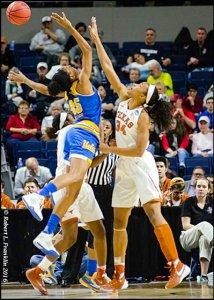 UCLA's Monique Billings and Texas' Imani Boyette battle for the rebound. Photo by Robert L. Franklin.