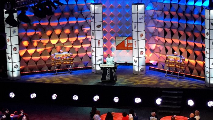 WNBA president Lisa Borders welcomes attendees and audience members to the draft. Photo by Rebecca Rider.