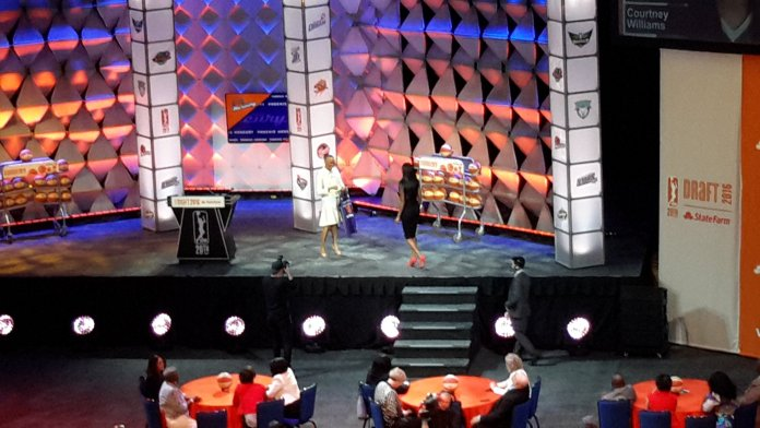 Courtney Williams ascends the stage after her selection by the Phoenix Mercury. Photo by Rebecca Rider.