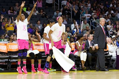 Candace Parker celebrates a Sparks run last summer as coach Brian Agler looks on. Photo by TGSportsTV1.
