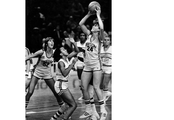 Oregon's Bev Smith (#24) puts up a shot against Louisiana State while teammate Allison Lang (#52) looks on, Dec. 16, 1981. Photo by Brent Wojahn.