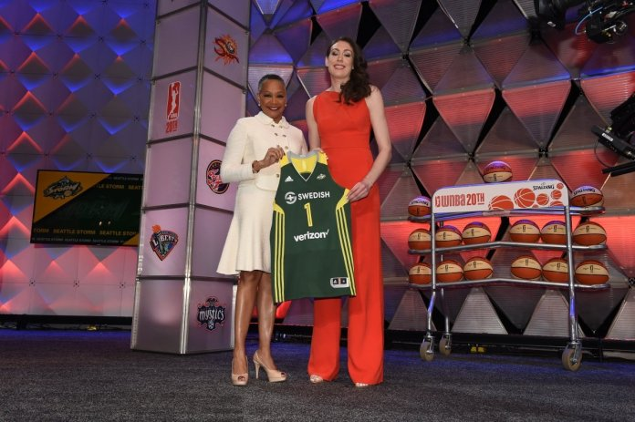 Breanna Stewart with WNBA President Lisa Borders after being selected first in the WNBA draft by the Seattle Storm. Photo by NBA Photos/Getty Images.