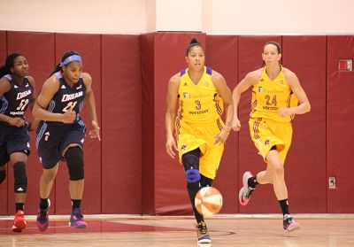 Candace Parker and Rebecca Tobin on the run for the Sparks, while Elizabeth Williams and Reshanda Gray trail for the Dream. Photo by Benita Wright/TGSportsTV1.