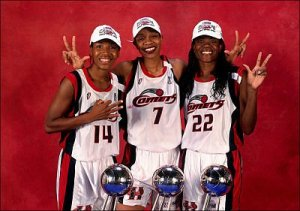 Cynthia Cooper, Tina Thompson and Sheryl Swoopes after winning their third WNBA Championship in 1999. All three made the league's top 20 players of all time list. Photo by cstv.collegesports.com.