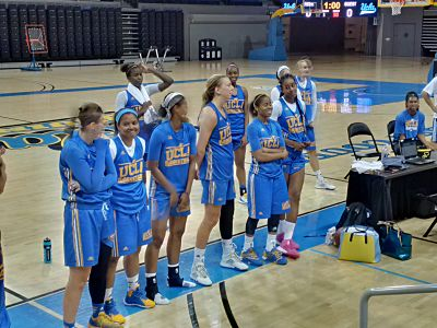 UCLA's large junior class talks with donors after practice. Photo by Sue Favor.