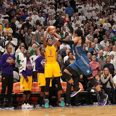 Alana Beard launches the shot, with 2 seconds remaining, over Maya Moore to put in the game-winning bucket for the Sparks. Photo by David Sherman/NBAE Getty Images.