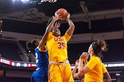 Kristen Simon muscles up for the basket. Photo by John McGillen.