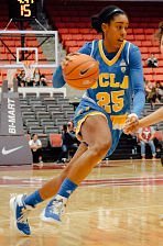Monique Billings takes the ball up court. Photo by uclabruins.com.