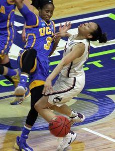 UCLA's Jordin Canada fouls Saniya Chong. Photo by Steve Slade.