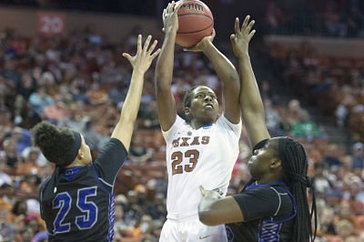 Ariel Atkins powers up a shot. Photo by Patrick Meredith/Texas Athletics.