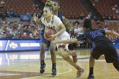 Brooke McCarty fights through defenders. Photo by Patrick Meredith/Texas Athletics.