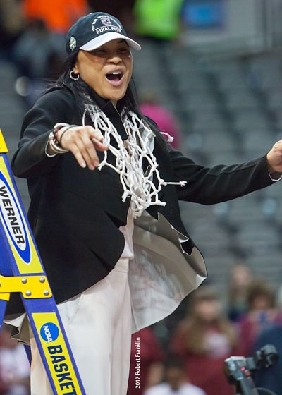 Dawn Staley climbs down the ladder after cutting donw the net. Photo by Robert L. Franklin.