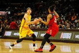 Sparks rookie Sydney Wiese looks to pass as Natasha Cloud guards her. Photo by Maria Noble/WomensHoopsWorld.