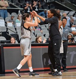 Veteran Monique Currie gives rookie Kelsey Plum encouragement as she comes out of the Star's first preseason game. Photo courtesy of San Antonio Stars.