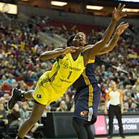 Crystal Langhorne extends for a rebound. Photo by Neil Enns/Storm Photos.