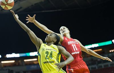 Jewell Loyd reaches past Elena Delle Donne for a layup. Photo by Neil Enns/Storm Photos.