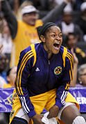 Alana Beard cheers from the bench as the Sparks went past the 100-point mark. Photo by Bret Hartman/AP.