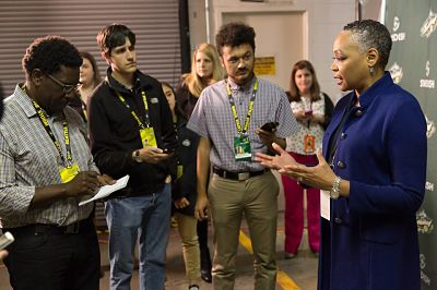 Lisa Borders talks to media members at Seattle's KeyArena Tuesday, following the Storm-Dream game. Photo by Neil Enns/Storm Photos.