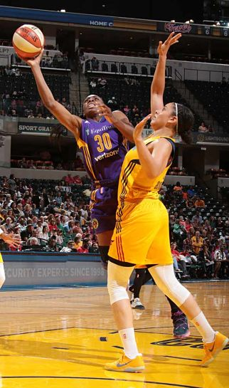Nneka Ogwumike shoots over Natalie Achonwa. Photo by NBAE via Getty Images.