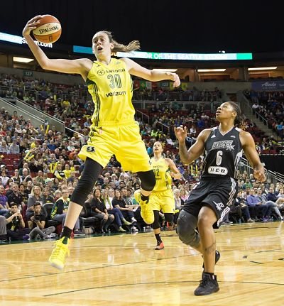 Breanna Stewart leaps for the ball save, as Alex Montgomery looks on. Photo by Neil Enns/Storm Photos.