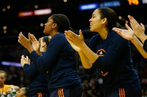 Connecticut Sun players applaud the efforts of their teammates on the floor. Photo by Maria Noble/WomensHoopsWorld.