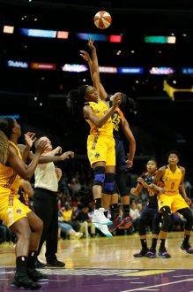 Nneka Ogwumike and Alyssa Thomas jump the ball. Photo by Maria Noble/WomensHoopsWorld.