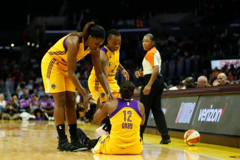 Jantel Lavender and Riquna Williams help Chelsea Gray up after a foul. Photo by Maria Noble/WomensHoopsWorld.