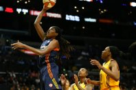 Jonquel Jones scores for the Sun. Photo by Maria Noble/WomensHoopsWorld.