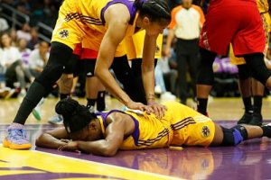 Candace Parker consoles Nneka Ogwumike after she is knocked to the floor. Photo by Maria Noble/WomensHoopsWorld.