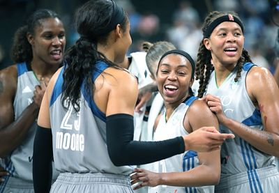 The Lynx celebrate their win over the Sparks. Photo by Elizabeth Flores/Minneapolis Star Tribune.