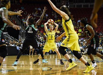 Sami Whitcomb looks to pass to Sue Bird. Photo courtesy of Seattle Storm.