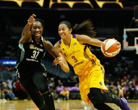 Tina Charles defends Candace Parker. Photo by Maria Noble/WomensHoopsWorld.
