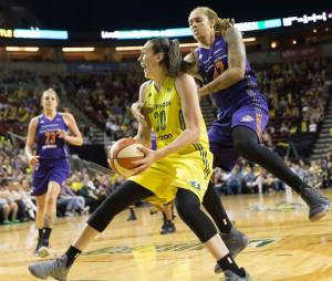 Breanna Stewart is defended by Brittney Griner. Photo by Neil Enns/Storm Photos.