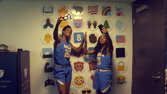 Monique Billings and Jordin Canada clapped out the UCLA fight song on Pac-12 media day while recording themselves. Photo courtesy of Pac-12 Networks.