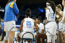 Players during a timeout. Photo by Maria Noble/WomensHoopsWorld.