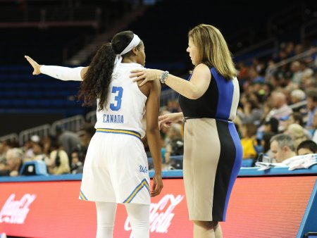 Jordin Canada and coach Cori Close talk strategy at a pause in game action. Photo by Maria Noble/WomensHoopsWorld.