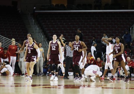 Aggie starters walk back to the bench at game's end, while USC players take in the loss. Photo by Maria Noble/WomensHoopsWorld.